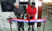 Man and Woman cutting ribbon